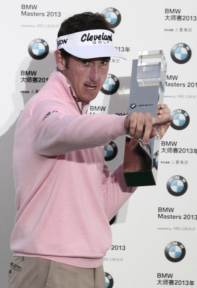 Spain's Gonzalo Fernandez-Castano poses with his trophy during the award ceremony of the BMW Masters golf tournament at the Lake Malaren Golf Club in Shanghai, China, Sunday, Oct. 27, 2013. Fernandez-Castano won the tournament, finishing on 11-under 277. (AP Photo)