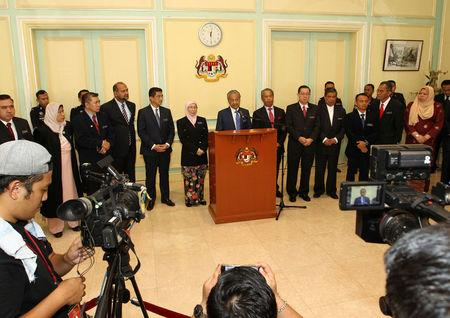 Malaysia's Prime Minister Mahathir Mohamad gives a news conference after a cabinet meeting in Putrajaya