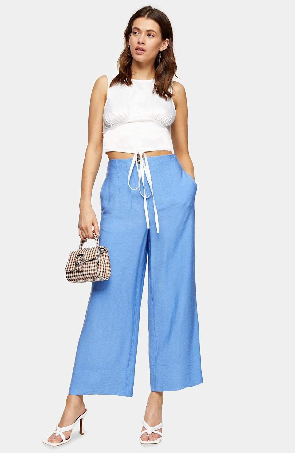 "<p>These comfy <a href=""https://www.popsugar.com/buy/Topshop-Aida-Stitch-Detail-Wide-Leg-Trousers-573074?p_name=Topshop%20Aida%20Stitch%20Detail%20Wide%20Leg%20Trousers&retailer=shop.nordstrom.com&pid=573074&price=55&evar1=fab%3Aus&evar9=47085485&evar98=https%3A%2F%2Fwww.popsugar.com%2Ffashion%2Fphoto-gallery%2F47085485%2Fimage%2F47462830%2FTopshop-Aida-Stitch-Detail-Wide-Leg-Trousers&list1=shopping%2Cpants%2Cworkwear%2Cfashion%20shopping&prop13=mobile&pdata=1"" class=""link rapid-noclick-resp"" rel=""nofollow noopener"" target=""_blank"" data-ylk=""slk:Topshop Aida Stitch Detail Wide Leg Trousers"">Topshop Aida Stitch Detail Wide Leg Trousers</a> ($55) are easy to mix and match with anything.</p>"