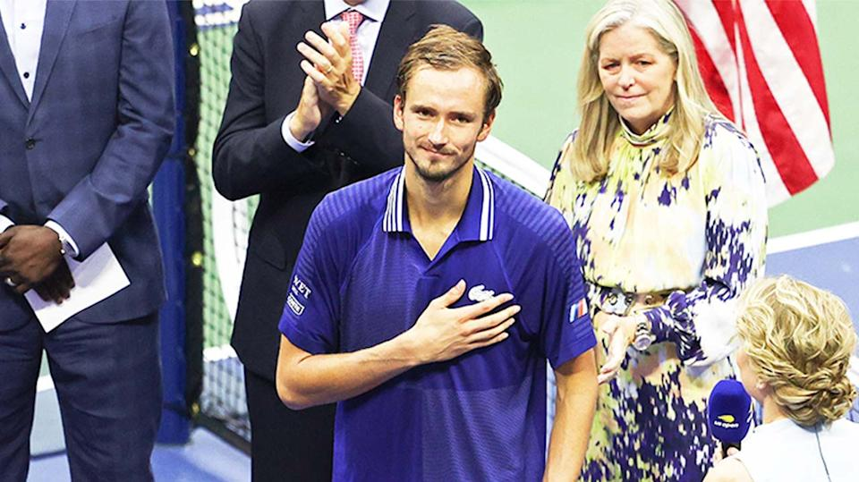 Daniil Medvedev (pictured) gestures on the podium after winning the US Open final.
