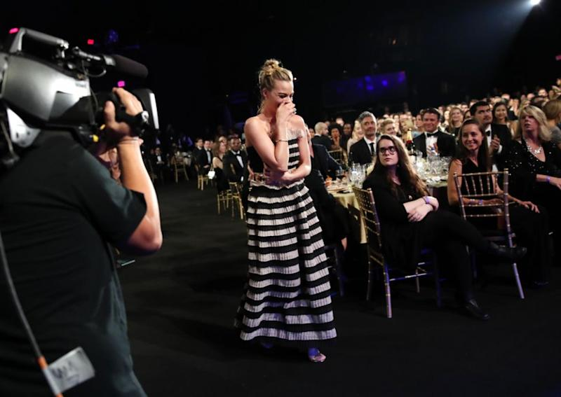 Margot Robbie is stunned as she wins Best Actress. Photo: Getty