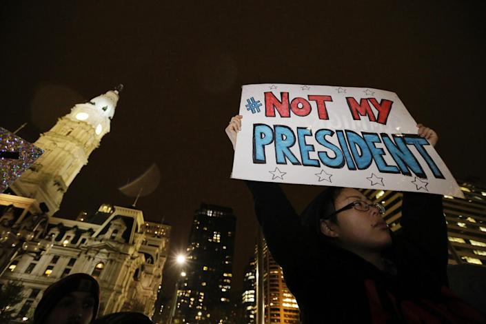 <p>Maddy Ballard, of Philadelphia, participates in a protest in City Hall's Thomas Paine Plaza, Wednesday, Nov. 9, 2016, in opposition of Donald Trump's presidential election victory. (Elizabeth Robertson/The Philadelphia Inquirer via AP) </p>