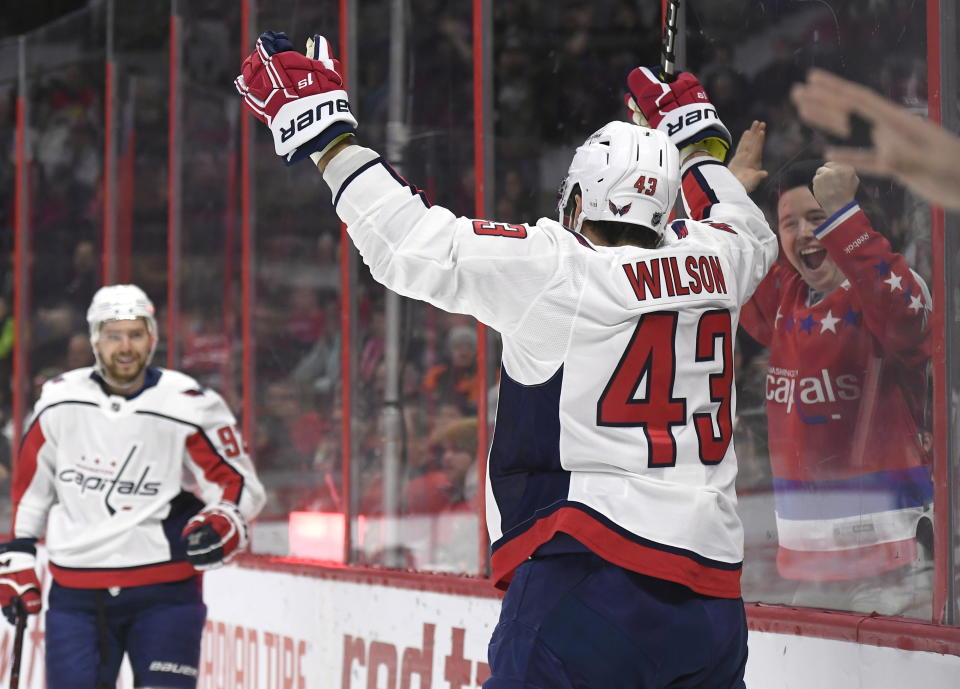 A fan cheers as Washington Capitals right wing Tom Wilson (43) celebrates his goal against the Ottawa Senators with center Evgeny Kuznetsov (92) during the first period of an NHL hockey game, Saturday, Dec. 29, 2018 in Ottawa, Ontario. (Justin Tang/The Canadian Press via AP)