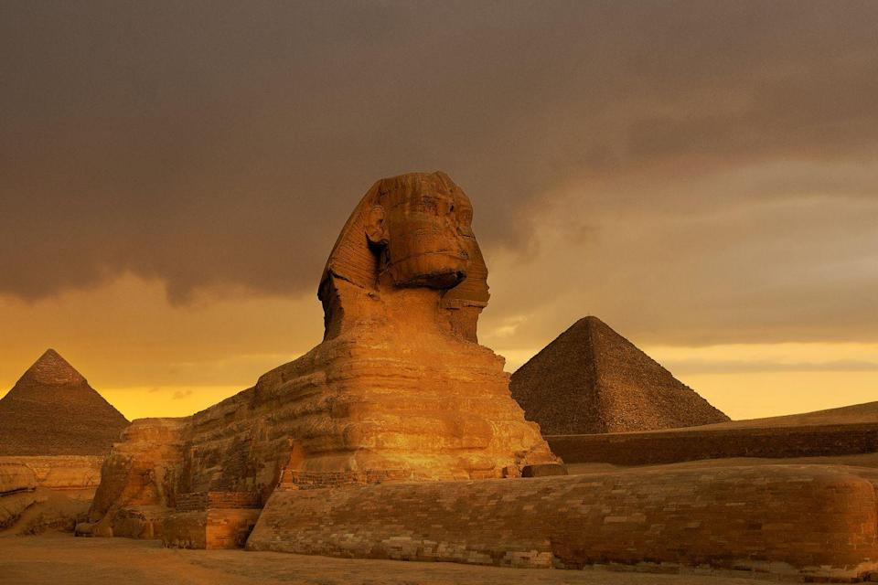 """<p>The Sphinx is a <a href=""""https://www.history.com/topics/ancient-egypt/the-sphinx"""" rel=""""nofollow noopener"""" target=""""_blank"""" data-ylk=""""slk:mythical figure"""" class=""""link rapid-noclick-resp"""">mythical figure</a> that serves as a spiritual guardian, hence why a large Sphinx monument was built at the site of the Great Pyramids, as per the request of Pharaoh Khafre.</p>"""