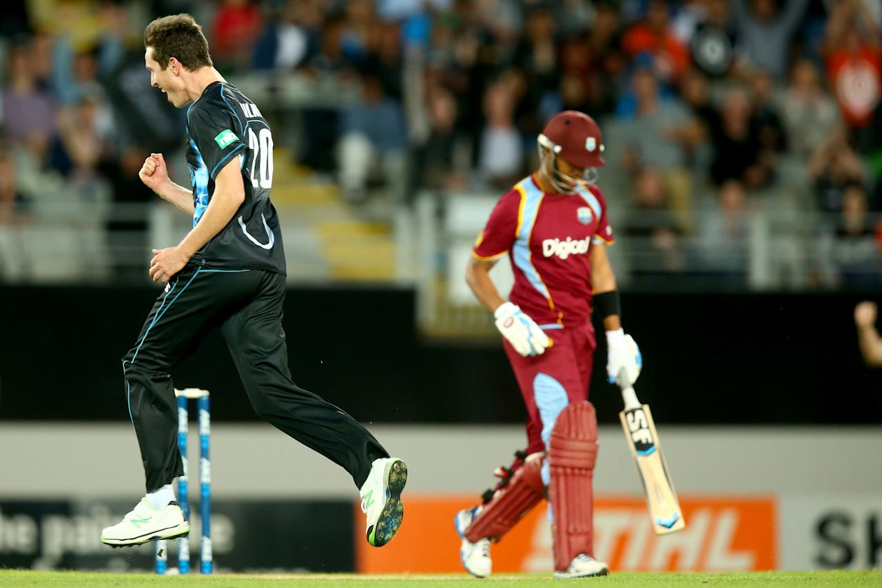 AUCKLAND, NEW ZEALAND - JANUARY 11: Adam Milne of New Zealand celebrates his wicket of Lendl Simmons of the West Indies during the first T20 between New Zealand and the West Indies at Eden Park on January 11, 2014 in Auckland, New Zealand.  (Photo by Phil Walter/Getty Images)