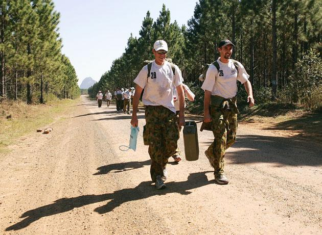 Australian coach John Buchanan and Jason Gillespie of Australia carry a jerry can of water during an outback boot camp training session in the Beerwah State Forest on August 23, 2006 near Brisbane, Australia.  (Photo by Hamish Blair/Getty Images)
