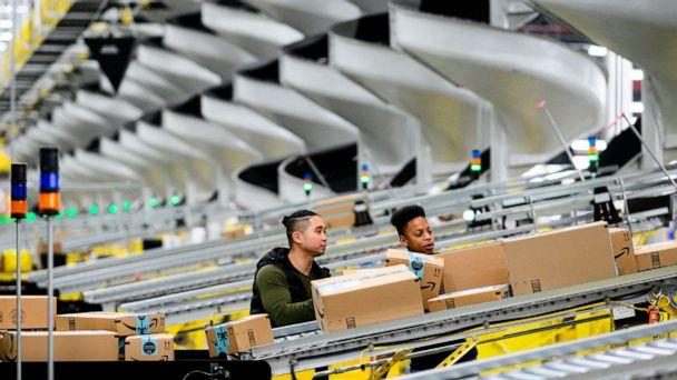 PHOTO: Men work in an Amazon fulfillment center in New York, Feb. 5, 2019. (Johannes Eisele/AFP via Getty Images, FILE)