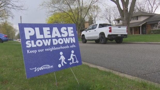 'Please Slow Down' signs have been placed on certain residential streets in Windsor. (Dale Molnar/CBC - image credit)