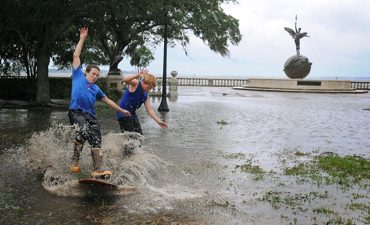 Connor Sidman, 12, right, and his friend Sean Frechette, 12, skim board around Memorial Park in Riverside, Fla., in the aftermath of Tropical Storm Beryl on Monday May 28, 2012. Beryl came ashore early Monday near Jacksonville Beach with near-hurricane-strength winds of 70 mph. (AP Photo/The Florida Times-Union, Kelly Jordan)