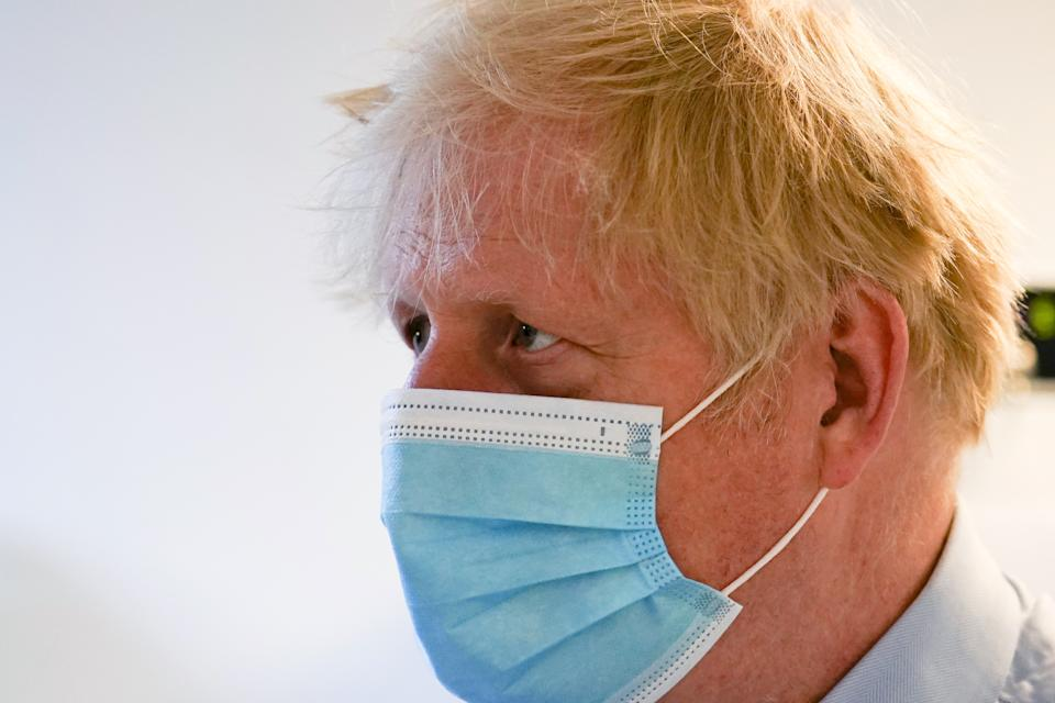 Boris Johnson is planning to drop face mask rules on 19 July, according to reports. (Alberto Pezzali/PA)
