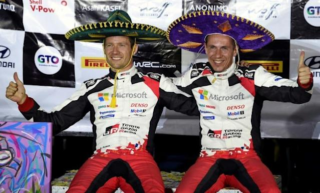 Sebastien Ogier and his co-pilot Julien Ingrassia after winning the Rally of Mexico (AFP Photo/ALFREDO ESTRELLA)
