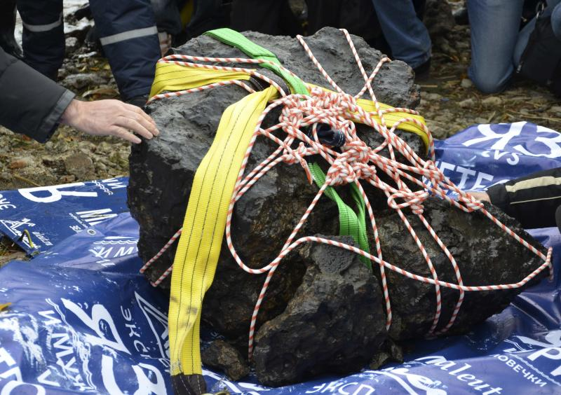 An object, which is a piece of a meteorite according to local authorities and scientists, is on display on the bank of the Chebarkul Lake
