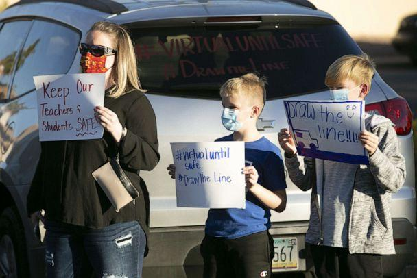 PHOTO: Parents and students protest schools reopening amid the COVID-19 pandemic at the Chandler Unified School District offices on Jan. 4, 2021, in Phoenix. (David Wallace/The Republic via Imagn Content Services, LLC. via USA Today)