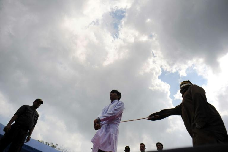 Gay couple condemned to public flogging by Indonesian Shariah court