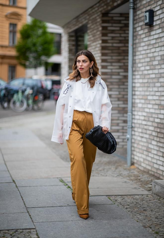 <p>Complete a simple blouse and trouser combination with an oversize Bottega clutch.</p>