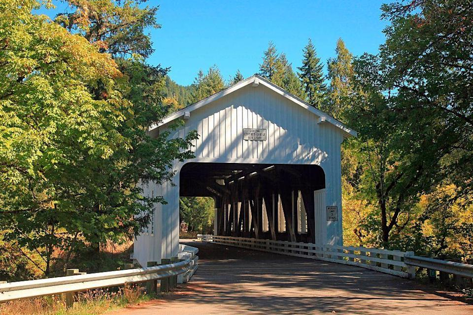 """<p>Known as the """"<a href=""""https://www.tripadvisor.com/Tourism-g51818-Cottage_Grove_Oregon-Vacations.html"""" rel=""""nofollow noopener"""" target=""""_blank"""" data-ylk=""""slk:covered-bridge capital"""" class=""""link rapid-noclick-resp"""">covered-bridge capital</a>,"""" the town offers a trail studded with seven covered bridges that connect the village across rolling hillside and a series of waterfalls and rivers. The delightful setting is home to plenty of great hiking and bicycling spots, as well as several cozy B&B retreats.</p>"""