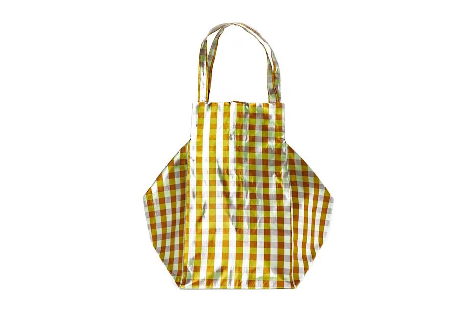 """$350, Coming of Age. <a href=""""https://coa-nyc.com/collections/all/products/xl-iridescent-yellow-everyday-bag"""" rel=""""nofollow noopener"""" target=""""_blank"""" data-ylk=""""slk:Get it now!"""" class=""""link rapid-noclick-resp"""">Get it now!</a>"""