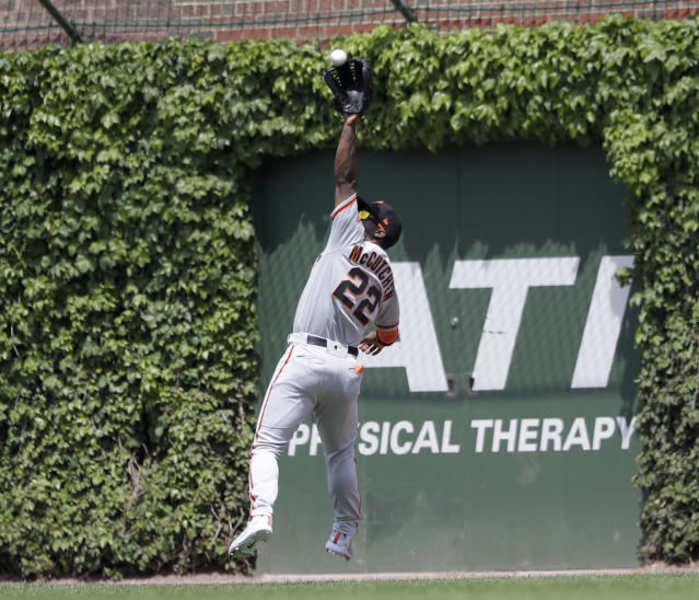 San Francisco Giants' Andrew McCutchen catches a deep fly ball from Chicago Cubs' Albert Almora Jr. during the third inning of a baseball game Friday, May 25, 2018, in Chicago. (AP Photo/Charles Rex Arbogast)