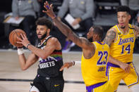 Denver Nuggets' Jamal Murray, left, is defended by Los Angeles Lakers' LeBron James (23) during the second half of an NBA conference final playoff basketball game Thursday, Sept. 24, 2020, in Lake Buena Vista, Fla. (AP Photo/Mark J. Terrill)