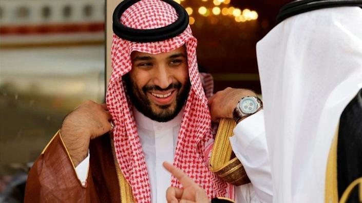 FILE - In this May 14, 2012 file photo, Prince Mohammed bin Salman speaks with a Saudi prince in Riyadh, Saudi Arabia. The disappearance of Saudi journalist and contributor to The Washington Post Jamal Khashoggi on Oct. 2, 2018, in Turkey peels away a carefully cultivated reformist veneer promoted about the Saudi Crown Prince, instead exposing its autocratic tendencies. The kingdom long has been known to grab rambunctious princes or opponents abroad and spirit them back to Riyadh on private planes. But the disappearance of Khashoggi, who Turkish officials fear has been killed, potentially has taken the practice to a new, macabre level by grabbing a writer who could both navigate Saudi Arabia's byzantine royal court and explain it to the West. (AP Photo/Hassan Ammar, File)