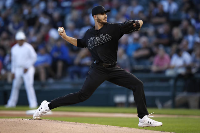 Chicago White Sox starting pitcher Dylan Cease delivers during the first inning of a baseball game against the Texas Rangers, Friday, Aug. 23, 2019, in Chicago. (AP Photo/Jeff Haynes)
