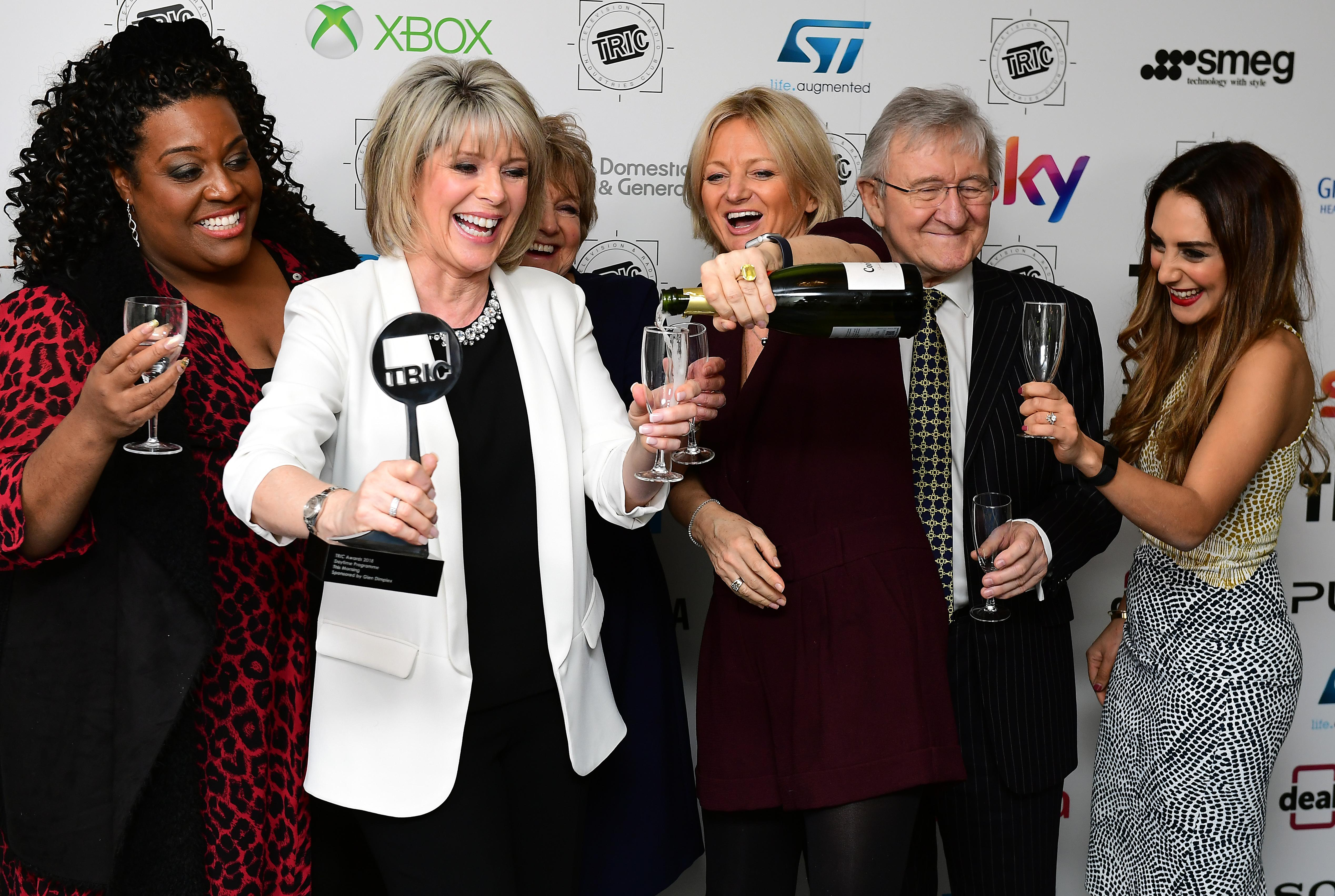 Chris Steele (second right), Ruth Langsford (second left), Alison Hammond (left), Alice Beer (third right) with the Daytime Programme Award for This Morning during the 2018 TRIC Awards at the Grosvenor House Hotel, London.