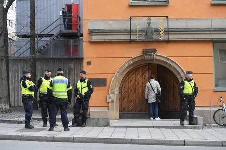 Police officers stand outside the Stockholm District Court as Uzbek national Rakhmat Akilov, prime suspect in Friday's truck attack, appears in court, in Stockholm