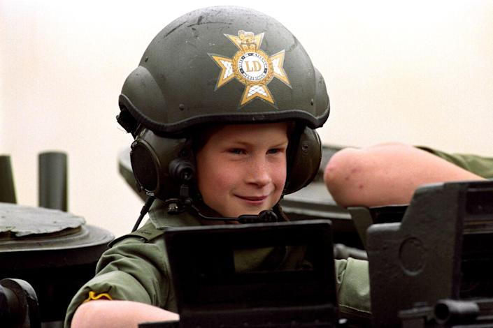 <p>Harry, 8, rides in a light tank during a visit to the Barracks of Light Dragoons in Hanover, Germany. The prince would later enroll at the Royal Military Academy Sandhurst and serve in Afghanistan with the Army Air Corps.</p>