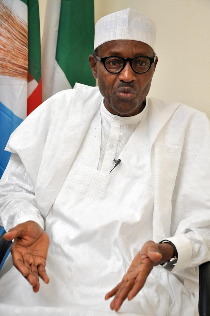 Leading opposition All Progressives Congress (APC) presidential candidate Muhammadu Buhari speaks during an interview in Abuja on February 6, 2015 (AFP Photo/)