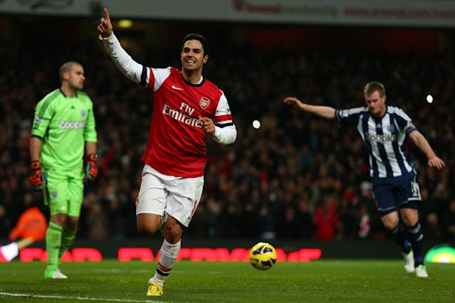 LONDON, ENGLAND - DECEMBER 08: Mikel Arteta of Arsenal celebrates scoring their second goal from the penalty spot during the Barclays Premier League match between Arsenal and West Bromwich Albion at Emirates Stadium on December 8, 2012 in London, England. (Photo by Clive Mason/Getty Images)