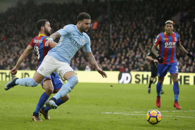 "<a class=""link rapid-noclick-resp"" href=""/soccer/players/kyle-walker/"" data-ylk=""slk:Kyle Walker"">Kyle Walker</a> (front) and Manchester City were tripped up by Crystal Palace, ending their 18-game win streak. (AP)"