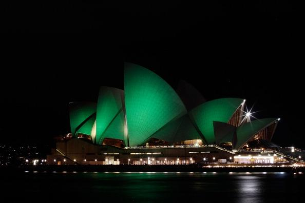 The Sydney Opera House is illuminated green on March 17, 2012 in Sydney, Australia. The Sydney Opera House joins Sky Tower in Auckland, and Table Mountain in South Africa in going green to celebrate St. Patrick's Day. (Photo by Brendon Thorne/Getty Images)