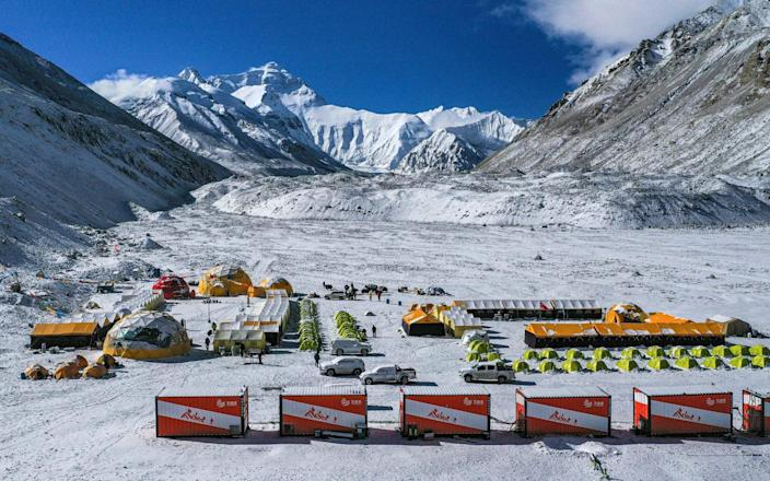 China has canceled attempts to climb Mount Everest from its side of the world's highest peak because of fears of importing COVID-19 cases from neighboring Nepal - Purbu Zhaxi / Xinhua