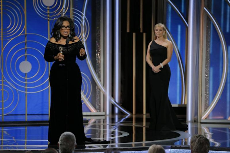 Reese looks on in awe as her friend Oprah delivers a historic speech at the Golden Globes. Source: Getty