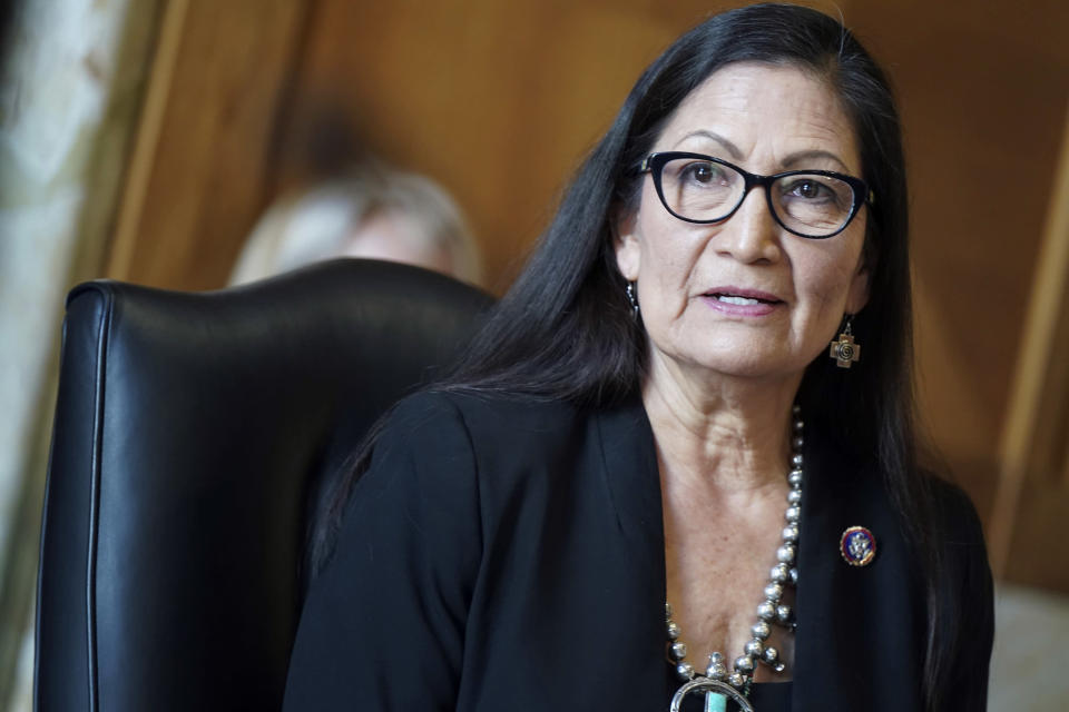 """FILE - In this Wednesday, Feb. 24, 2021, file photo, then-Rep. Debra Haaland, D-N.M., testifies before a Senate Committee on Energy and Natural Resources hearing on her nomination to be secretary of the interior, on Capitol Hill in Washington. Haaland, a former two-term New Mexico congresswoman, said she is committed to """"strike the right balance"""" as interior manages oil drilling and other energy development, while seeking to conserve public lands and address climate change. (Leigh Vogel/Pool via AP, File)"""