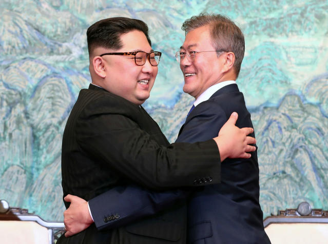 <p>North Korean leader Kim Jong Un, left, and South Korean President Moon Jae-in embrace each other after signing on a joint statement at the border village of Panmunjom in the Demilitarized Zone, South Korea, Friday, April 27, 2018. (Photo: Korea Summit Press Pool via AP) </p>