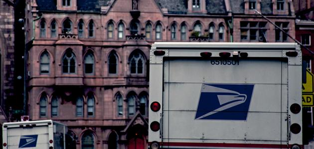 Mail trucks in front of Cooper Station post office in East Village, New York City. (photo: Siemond Chan)