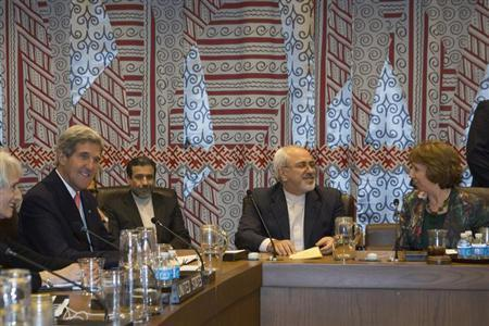 U.S. Secretary of State John Kerry (L), Iran's Foreign Minister Mohammad Javad Zarif (2nd R) and European Union High Representative Catherine Ashton (R) are seated during a meeting of the foreign ministers representing the permanent five member countries of the United Nations Security Council, including Germany, at UN Headquarters in New York September 26, 2013.