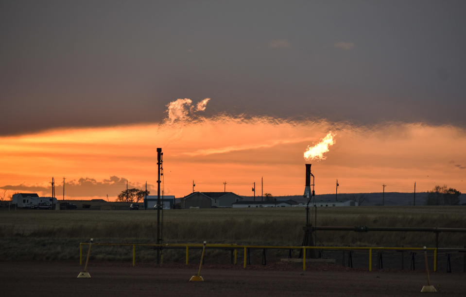 n this Tuesday, May 18, 2021, photo, flares burn natural gas from oil production in the Fort Berthold Indian Reservation east of New Town, North Dakota. Oil pumped from Native American lands in the U.S. increased about tenfold since 2009 to more than 130 million barrels annually, bringing new wealth to a small number of tribes. Tribes left out of the drilling boom have become increasingly outspoken against fossil fuels as climate change's impacts grow worse. (AP Photo/Matthew Brown)