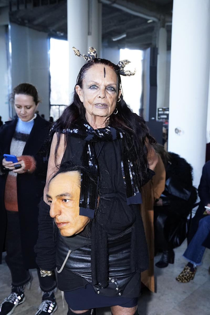 Totally weird and perfectly funny: Michèle Lamy at the Rick Owens show, carrying Rick Owens's head. Photo by Peter White/Getty Images.