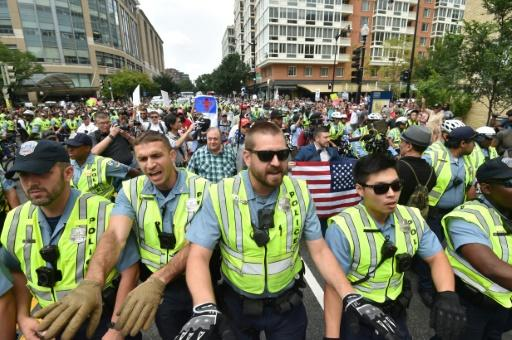 Police escort far-right demonstrators during a rally at Lafayette Park opposite the White House