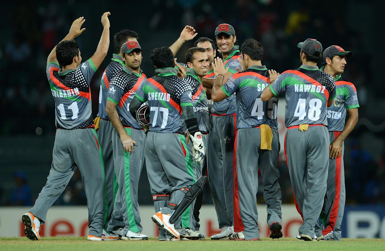 COLOMBO, SRI LANKA - SEPTEMBER 19:  Karim Sadiq of Afghanistan celebrates with teammates after dismissing Yuvraj Singh of India during the  ICC World Twenty20 2012: Group A match between India and Afghanistan at R. Premadasa Stadium on September 19, 2012 in Colombo, Sri Lanka.  (Photo by Gareth Copley/Getty Images,)