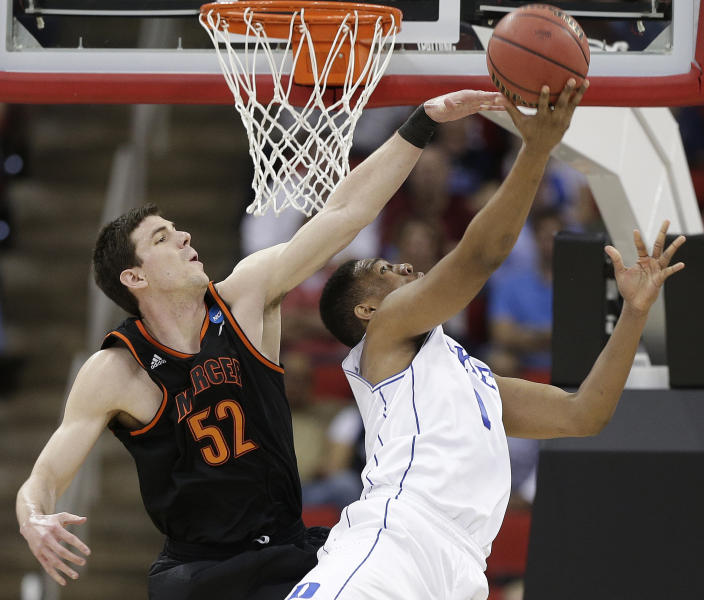 Duke forward Jabari Parker (1) shoots against Mercer forward Daniel Coursey (52) during the first half of an NCAA college basketball second-round game, Friday, March 21, 2014, in Raleigh, N.C. (AP Photo/Chuck Burton)