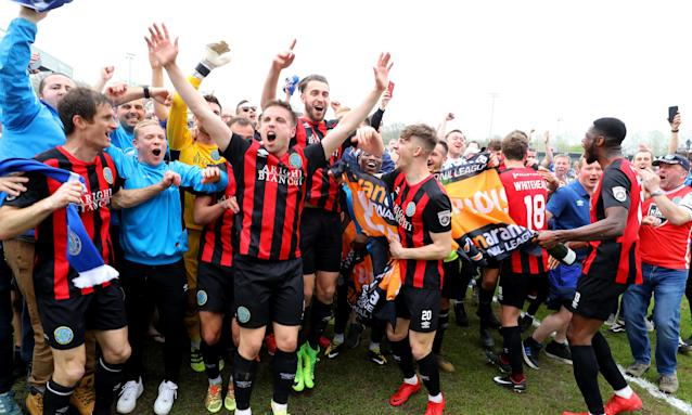 Macclesfield Town players celebrate after gaining promotion at Eastleigh.