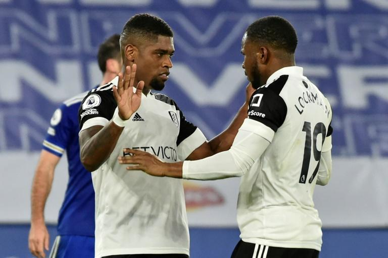 Fulham's Ivan Cavaleiro (L) celebrates with Ademola Lookman