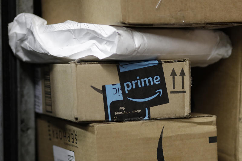 """In this Tuesday, May 9, 2017, photo, a package from Amazon Prime is loaded for delivery on a UPS truck, in New York. Amazon is extending its annual """"Prime Day"""" promotion to 30 hours this year. Amazon will offer discounts and other deals in an effort to boost sales during the slower summer months. This year's Prime Day will start at 9 p.m. ET on July 10, 2017. While Amazon has claimed success, there have been grumblings that Prime Day deals have been unimpressive or involve older models. (AP Photo/Mark Lennihan)"""