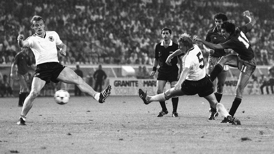 Spanish forward Eurico (R) shoots on goal under pr | STAFF/Getty Images