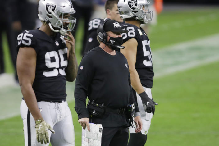 Las Vegas Raiders head coach Jon Gruden watches from the sideline during the second half of an NFL football game against the Denver Broncos, Sunday, Nov. 15, 2020, in Las Vegas. (AP Photo/Isaac Brekken)