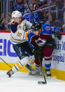 Buffalo Sabres defenseman Rasmus Ristolainen (55) and Colorado Avalanche right wing Mikko Rantanen (96) collide during the first period of an NHL hockey game Saturday, March 9, 2019, in Denver. (AP Photo/Jack Dempsey)