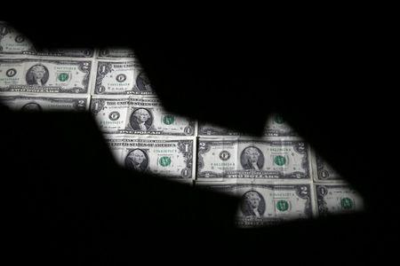 U.S. dollar banknotes are seen through a printed stock graph in this illustration taken February 7, 2018. REUTERS/Dado Ruvic/Illustration